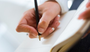 Detail of Beautiful young woman writting